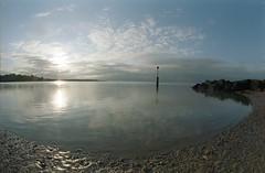 Morning glory with a fish called dory. (von8itchfisk) Tags: film ishootfilm 35mm analogue analog expiredfilm kodak kodacolour sea beach northsea riverdeben felixstowe suffolk eastanglia coast olympus om10 vonbitchfisk sunrise reflection