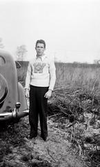 1933WorldsFair0017.jpg (The Digital Shoebox) Tags: monochrome guy 1933 outside skyride centuryofprogress chicago collegesweater buildings 20thcentury family blackandwhite worldsfair people