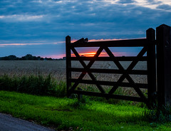 Silhouetted Gate (Nigel Wallace1) Tags: sunset colours colour colourful woodengate blue green nature beautyinnature england cloud clouds cloudscape olympus omdem1mk11 1240mm leefilters flickr