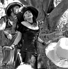 Song (Demmer S) Tags: singing dramatic passion sing drama kingrichard'sfaire renaissance fair outdoors marketplace handmade crafts crystals pottery feasting vendors artisans jewelry musicians singers dancers minstrels mimes jugglers magicians comedians puppeteers exotic acrobats mud mudbeggars folklore facepainting tattoos camelrides magical fairy romantic gnomes dancing festival pirates wizards people peoplewatching documentary candid person blackandwhite monochrome knights medieval rowdy jousting revelry horses dragons king queen games ale beer turkeylegs princess costumes woods forest hats bristolfaire stages astrology fairies wenches fireeaters funwithtags