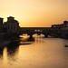 Sunset behind ponte Vecchio in Florence