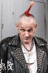 Face off (eyecandyclick) Tags: studdedleatherjacket punkrocker mohican chains razorblade earring piercings tattoos safetypin padlock rippedtshirt rebellion2017 streetportrait england thisisengland