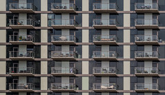 Rear Window. (Jovan Jimenez) Tags: balcony view rear window vintage manual focus lens lines shapes building sony ilce 6500 a6500 alpha 100mm nikon seriese series e eseries f28 telephoto miniature chicago high rise mirrorless