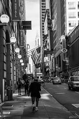 Somewhere in NYC (antoniomolitierno) Tags: new york city nyc usa united states stati uniti monocromo monocromatico bn bw bianco nero broadway times square uomo strada bandiera taxy grattacieli camminare insegne luci man street flag skyscrapers walk insignia lights canon eos 760d 18135 chryslerbuilding newyork manhattan