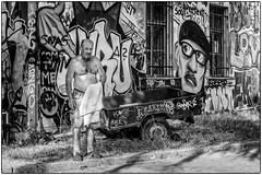 Tu crois qu'il m'a vu? (bertranddorel) Tags: tag streetphoto street metelkova ljubljana rue noiretblanc bw blackandwhite urban ville town humain art graffiti graff urbanart streetart paintedstreetart paintedstreetwalls urbanwalls painting