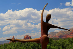 One with Nature (studioferullo) Tags: art beauty bright colorful colourful colors colours contrast dark design detail downtown edge light metal natural outdoor outside perspective pattern pretty scene serene tranquil sky study sunlight sunshine street texture tone weathered world sedona arizona statue sculpture dance dancer cloud mountain landscape leg arm body form