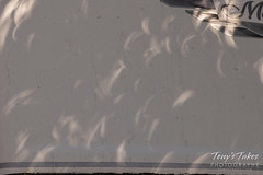 Crescent shadows of the eclipse on an RV