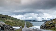 Summertime in Norway (Tommy Høyland) Tags: noruega landscape cloudy water outdoor one fujifilm clouds norway fv55 summer norvegen road cold xt2 car vista sognefjellet snow nobody desolate wide linje