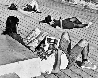 Reading Books, Magazines, Messages in the smartphone , The last one Sleeping (Common Point : Enjoying the Lisbon September Sun)