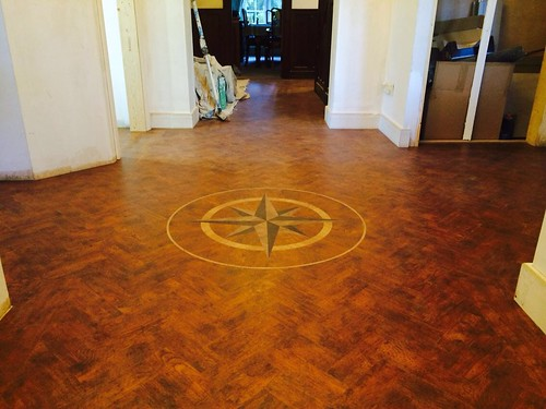 Amtico herringbone in priory oak with motif