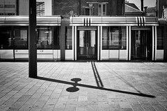 Follow the shadow (Vanvan_fr) Tags: noiretblanc bw nb blackandwhite tram tramway ombre shadow urban urbain vide empty batiments buildings lines rue street city ville tours tourscity carlzeiss zeiss distagon distagon352zf distagon352zf2 nikon df nikondf ff fullframe 35mm france photo