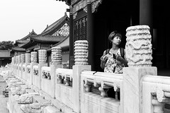 Everybody is looking for something (Go-tea 郭天) Tags: pékin beijingshi chine cn beijing forbidden city woman lady young phone mobile cell cellular cellphone photo hands full shadow backpack candid portrait beautiful surprised distrubed old traditional tradition palace history historic historical buildings construction frame framed light dark attention distraction tourist visitor street urban outside outdoor people bw bnw black white blackwhite blackandwhite monochrome naturallight natural asia asian china chinese canon eos 100d 24mm prime ancient lines perspective