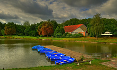Waiting for the tourists. (alex.vangroningen) Tags: houses boats sky outdoors clouds water lake trees grass blue red green