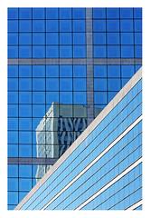 Un petit coin d'immeuble (Marie Hacene) Tags: ladéfense immeubles fenêtres reflets architecture building lines sky geometric façade