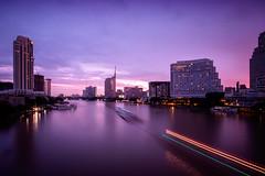 Chao Phraya in the morning (ajecaldwell11) Tags: lights longexposure highrise river purple dawn sunrise buildings clouds bangkok xe2 fujifilm thailand caldwell ankh