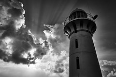 Johor Straits Lighthouse, Singapore (singaporebugtracker) Tags: singaporebugtracker rafflesmarinalighthouse johorstraitslighthouse singapore clouds monochrome blackandwhite vintage guidepost watchtower stormy beacon observatory dark lighthouse sunbeam radiance