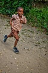Running to school (Pejasar) Tags: westafrica ghana winneba student run boy
