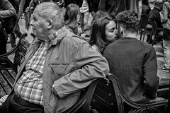 the old and the lovers (Daz Smith) Tags: dazsmith fujixt20 fuji xt20 andwhite bath city streetphotography people candid portrait citylife thecity urban streets uk monochrome blancoynegro blackandwhite mono older man young lovers kissing