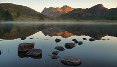 Another Blea Tarn Sunrise (Andy Watson1) Tags: countryside misty shoreline langdales still serene calm blea tarn sunrise langdale pikes side pike sidepike pikeostickle harrisonstickle morning light shadow reflection rocks mist atmosphere atmospheric early lake district national park lakedistrict cumbria cumbrian england english uk united kingdom great britain british landscape view scenery scenic nationaltrust outdoor nature sky blue white green fell fells mountain mountains hill summer september canon 70d sigma travel trip vacation