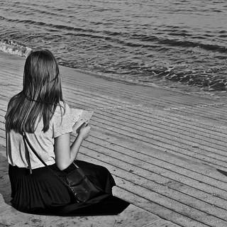 Girl reading the Lisbon Map at the Tagus River