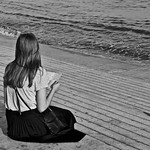 Girl reading the Lisbon Map at the Tagus River thumbnail