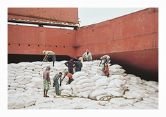 015_23 by jimbonzo079 - Cargo Hold - Discharging 6.000 of 30.000 tons of cargo Anchorage - Outfall of Hooghly River - Bay of Bengal - India - 1/7/2015  Name: - IMO: - Flag:Liberia MMSI: - Callsign: - Vessel type:Bulk Carrier Gross tonnage:24,533 tons Summer DWT:42,584 tons Length:188 m Beam:31 m Draught:8.7 m Home port:Monrovia Class society:Bureau Veritas Build year:1997 Builder:Split Shipyard Split, Croatia Owner:-  Canon AE-1 & FD 50mm f1.8 Lens Kodak Portra 160