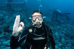 Ummm.  Not Okay! (- drsteve -) Tags: scuba diving underwater okay malpelo mask problem cracked bubbles diver ok portrait funny trouble shattered glass broken leaking