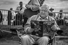Not Much For The Prelude (Leanne Boulton) Tags: monochrome people urban street candid portrait portraiture streetphotography candidstreetphotography candidportrait streetportrait streetlife old man elderly face facial expression look emotion feeling mood reaction scottishinternationalairshow airshow event aircraft tone texture detail depthoffield bokeh naturallight outdoor light shade shadow city scene seaside human life living humanity society culture canon canon5d 5dmkiii 70mm ef2470mmf28liiusm character black white blackwhite bw mono blackandwhite ayr scotland uk