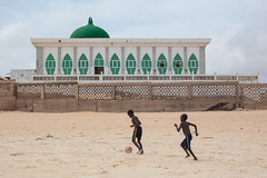 Football in front of the Mosque (Geraint Rowland Photography) Tags: football footballers childrenplayingfootball games footballonthebeach africans africanchildren africanfootball footballinsenegal plagedeyoff dakar senegal mosque yoffmosque mosquesinafrica westafricanmosques islam muslim islamcultureinsenegal senegalese beach geraintrowlandphotography worldtravel