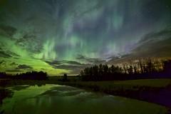 Green night  in August (John Andersen (JPAndersen images)) Tags: alberta aqua canada150 clouds harmatten light morainelake mountain smoke summer sylvanlake