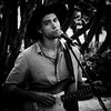 0246937258-92- Busker Playing and Singing in Balboa Park San Diero-4-Black and White (Jim There's things half in shadow and in light) Tags: 2017 balboapark californis canon5dmarkiv sandiego september sigma24105mmf4dg vacation guitar blackandwhite musician music people man