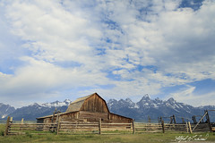 Big Sky Over The Barn_27A0152 (Alfred J. Lockwood Photography) Tags: alfredjlockwood nature landscape barn mormonrow bigsky clouds fence grandtetonnationalpark summer morning wyoming rockymountains antelopeflats