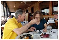 Paul sharing His Clams with Judy at Waters Edge Restaurant Mt Pleasant South Carolina (Barbara Brundage) Tags: paul sharing his clams with judy waters edge restaurant mt pleasant south carolina