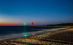 Lighthouse Lights (Explored) (T P Mann Photography) Tags: stones shore sand beach stars sky color reflections railing pier exposure long waves nightfall dusk dark evening night sundown sunset sunlit sun charlevoix michigan lake lighthouse light