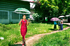 Burmese woman with rice for monks near Maesot Thailand (JJ Doro - Bangkok) Tags: burmese maesot moieriver myanmar rimmoie seasia thaimyanmarfriendshipbridge thailand thanaka umbrella asia asian asianmarket tambonthasailuat tak th