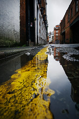 Bunsen Street, Manchester (nickcoates74) Tags: a6000 ilce6000 manchester september sony uk puddle rain yellow reflection bunsenstreet bunsenst northernquarter ancoats samyang 12mm 12mmf20