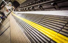 Go Faster Stripe (DobingDesign) Tags: london londonunderground yellow yellowline mindthegap tube tubestation tfl platform waiting tracks lines pattern bumps texture bokeh depthoffield markings