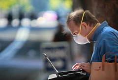 Data Masking (Ian Sane) Tags: ian sane images datamasking laptop computer mask man bad air quality wildfire smoke candid street photography downtown portland oregon southwest 6th avenue canon eos 5ds r camera ef70200mm f28l is usm lens