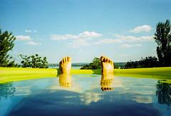 summer chill (brenkee) Tags: summer pool legs clouds sky vivid blue water lake film analog xpro crossprocessed c41 slidefilm olympus mju 35mm 28 pns pointandshoot compact