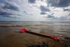 Red (DSNINE) Tags: dsnine bridlington sand sea spade red rubbish sky