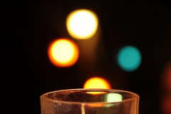 Party atmosphere (martinasalvatori1) Tags: tealights lights blue orange glass board party