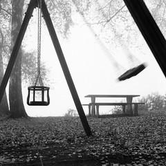 swingin' autumn (emanuele_f) Tags: autumn fall playground swings park nopeople kiev88cm volna3 80mm 6x6 mediumfomat ilford fp4 xtol 11 blackandwhite film analog