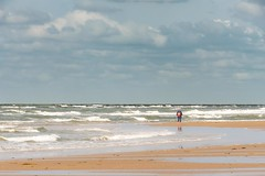 Alone (aj.lindeboom) Tags: beach clouds alone egmond