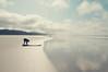 Golden Sands (Angelk32) Tags: tokina to tofino beach sea sand pacificocean d90 nikon dslr beachphotography vancouverisland westcoast canada longbeach 1116mmf28 wideangle britishcolumbia bc nature surfer surfing shoreline crossprocessed