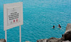 No Swimming (tcees) Tags: avreyesdeespaña puertodelrosario fuerteventura canaryislands nikon d5200 1855mm water sign people swimming swimmers rocks atlantic canaries allfreepicturesseptember2017challenge blue colour