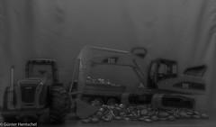 There is much to do (Günter Hentschel) Tags: bruder bruderspielwaren bagger trecker bierstöpsel bierdeckel verrücktebilder verrückt dieanderenbilder hentschel flickr indoor deutschland germany germania alemania allemagne europa nrw nikon nikond5500 d5500 einfarbig sw bw