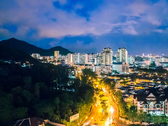 7:49 PM in Penang (Stratman² - (Joey and I are both ill )) Tags: canonphotography powershotg1x skyline bukitjambul penang buildings iso1600 clouds sky lights colorful city lowlightphotography colorfulworld
