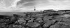 PortlandBillLighthouse-2 (stugee) Tags: fuji xe2 x e2 xe 2 doreset weymouth west country samyang rokinon 12mm f20 mono noir monochrome black white bw bn blanc et negre isle portland bill stone sky cloud lighthouse sea coast water