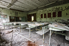 Schools Out (Gavmonster) Tags: nikon nikond7000 d7000 gswphotography abandoned derelict decay rust urbandecay architecture urban disused dramatic remnant building urbex urbanexploration peelingpaint window dirt wood chernobyl exclusionzone 30km ukraine nucleardisaster nuclearreactor ussr 1986 radiation prypiat ghosttown ceiling school classroom books seats bench lights tiles