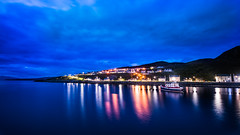 Mallaig (Kjeldvdh) Tags: harbour coast coastline houses water reflection scotland clouds gloomy blue hour mountain longexposure long exposure lights lichte lamps colours boat schiff schip ship